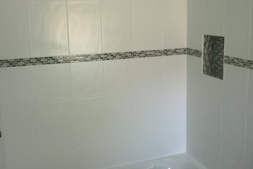 Laundry and Bathroom Renos South Dr Burlington Bath Tub install Border tiles Paint Plumbing Nook Niche By Adept Services Renovation Contractor