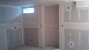Taping Drywall in Basement in Milton ON By Adept Services Drywall Contractor