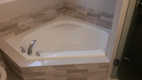 Bathroom Reno Bath Tub Stone Surround Marble Threshold Frameless Shower Glass Door in Oakville By Adept Services